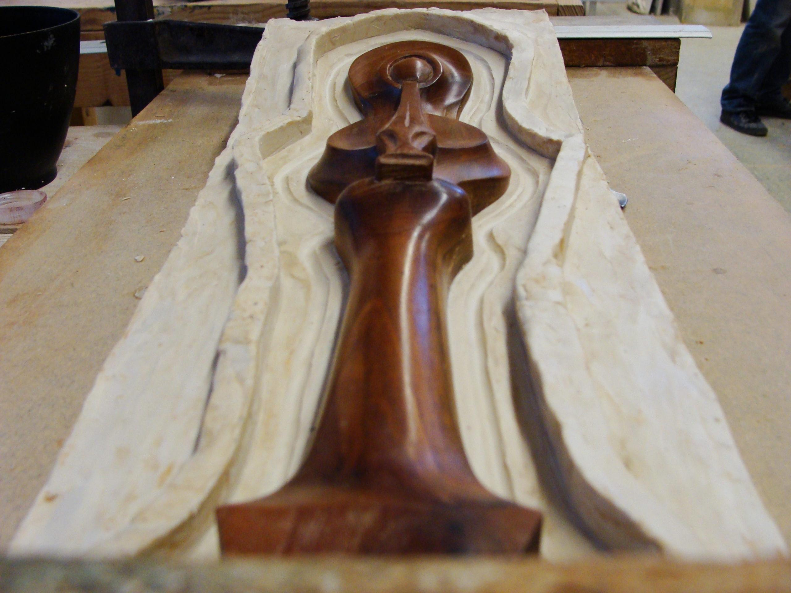 Flutiste en bois dans un moule élastomère